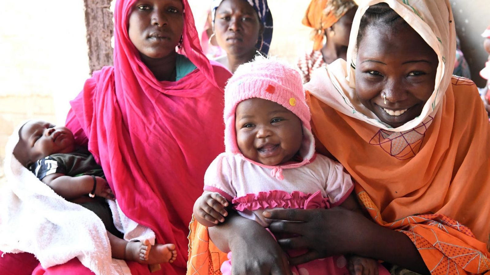 Mothers and children are waiting for their turn to be vaccinated at the health center of Ambatta, a suburban of Ndjamena, the capital of Chad. © UNICEF/UN0291197/Frank Dejongh