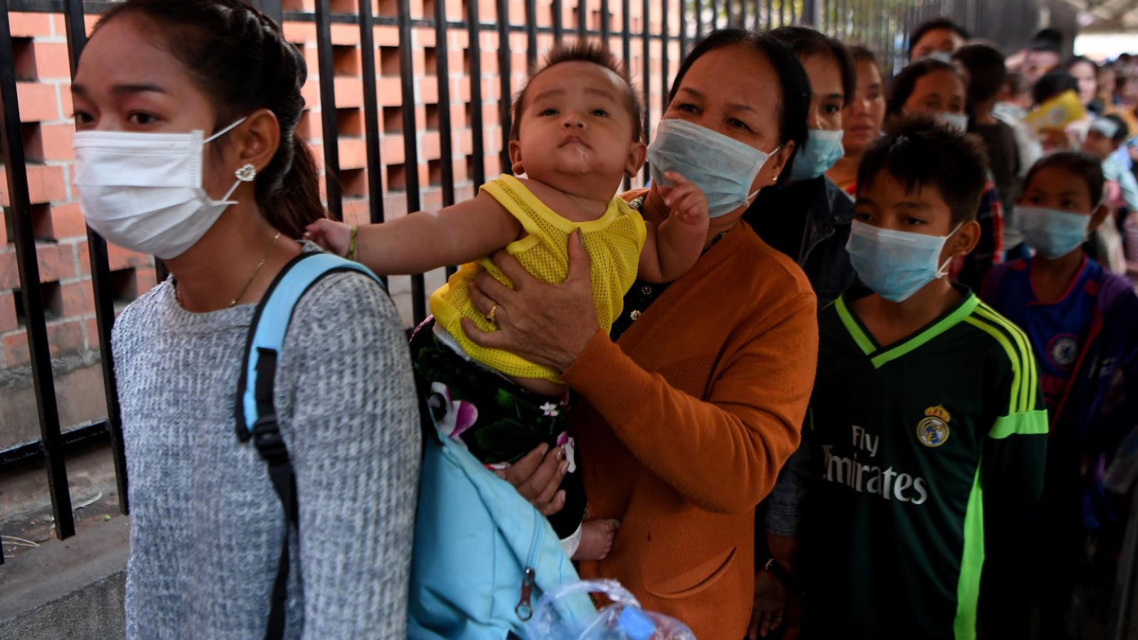 People wear face masks as they wait to enter a children's hospital in Phnom Penh on January 30, 2020