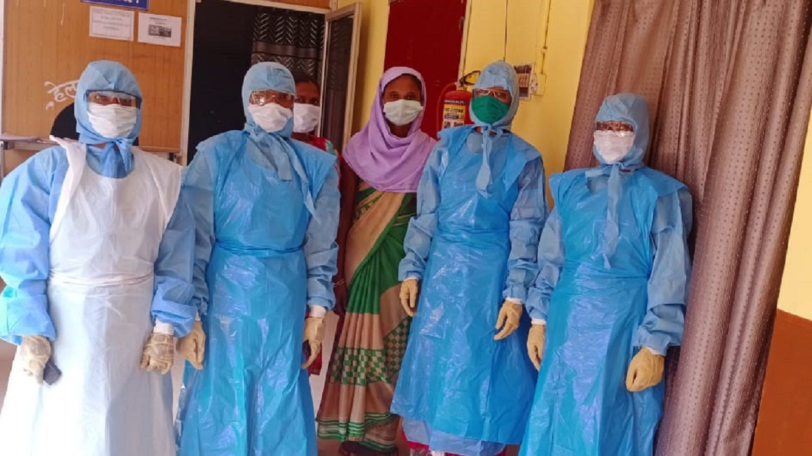 Healthcare workers wearing PPE