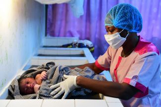 children-medical-worker-care: © UNICEF/UNI325620/Frank Dejongh